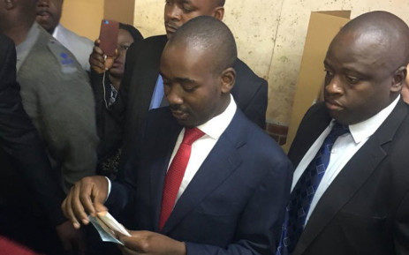 MDC Alliance leader Nelson Chamisa (wearing red tie) prepares to cast his vote in Zimbabwe's presidential elections on 30 July 2018. Picture: EWN