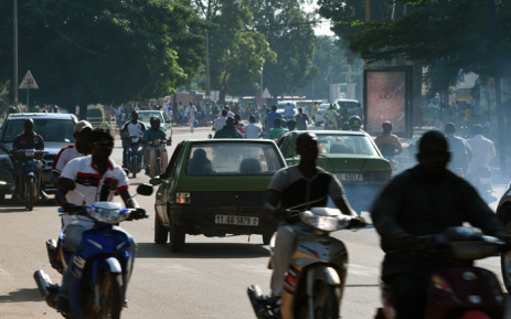 FILE: Vehicles run in a street of Ouagadougou in Burkina Faso, on 21 September, 2015. Picture: AFP.