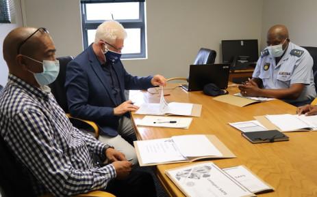 Premier Alan Winde (middle) at the Lentegeur police station on Tuesday, 12 October 2021. Picture: Alan Winde/Twitter