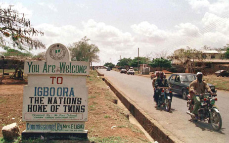 FILE: A signpost welcomes visitors to the southwestern Nigerian town of Igbo-Ora, the 'nation's home of twins'. Picture: AFP