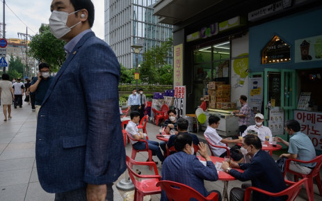 FILE: Diners at a street cafe in Seoul on 31 August 2020. Picture: AFP.