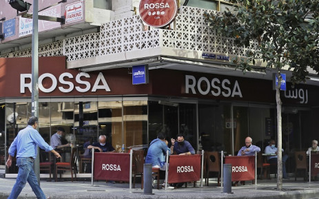 Patrons, mask-clad due to the COVID-19 pandemic, sit at a cafe in the Hamra neighbourhood of Lebanon's capital Beirut on 2 November 2020.Picture: AFP.