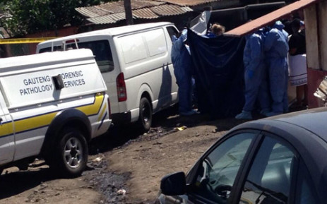 FILE: Forensic teams remove the bodies of Yonelisa and Zandile Mali from a toilet cubicle in Diepsloot, where they were dumped after being kidnapped & raped. Picture: EWN.