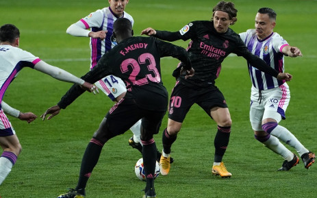 Real Madrid's Croatian midfielder Luka Modric (2R) vies with Real Valladolid's Spanish midfielder Roque Mesa during the Spanish league football match between Real Valladolid FC and Real Madrid CF at the Jose Zorilla stadium in Valladolid on February 20, 2021. Picture: Cesar Manso / AFP.