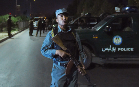 FILE: Afghan security personnel stand guard near the site of an explosion that targeted the elite American University of Afghanistan in Kabul on August 24, 2016. Picture: AFP.