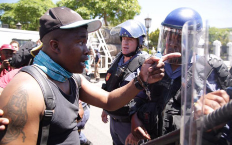Fees Must Fall protesters have clashed with the police outside Parliament. Picture: Anthony Molyneaux/EWN.