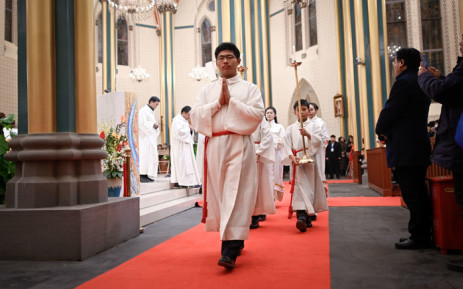 FILE: Chinese Catholic clergy attend a mass during the Christmas Eve at a Catholic church in Beijing on 24 December 2018.  Picture: AFP