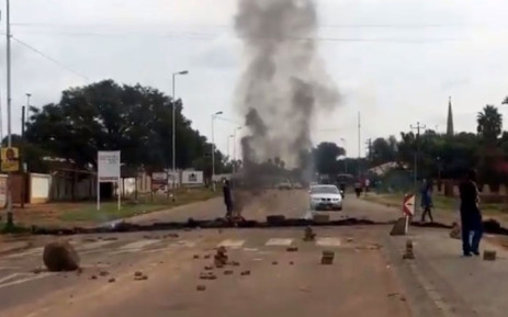 Protesters block roads with burning tyres and rocks as they shut down the area in Hammanskraal. Picture: EWN