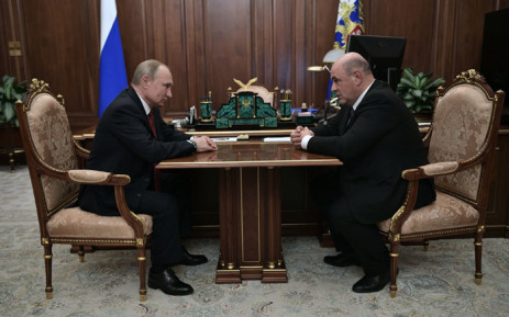 Russian President Vladimir Putin meets with Russia's tax service chief Mikhail Mishustin in Moscow on 15 January 2020. President Vladimir Putin on Wednesday formally proposed the head of Russia's tax service Mikhail Mishustin for the post of prime minister, news agencies reported. Picture: AFP