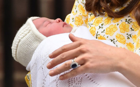 Britains Catherine, Duchess of Cambridge holds her newly-born daughter, her second child with Britains Prince William, Duke of Cambridge, as they show her to the media outside the Lindo Wing at St Marys Hospital in central London, on 2 May, 2015. Picture: AFP.