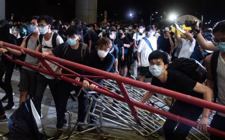 FILE: Protesters block the protest area of Legislative Council with barricades during clashes with police after a rally against a controversial extradition law proposal in Hong Kong on 10 June  2019.