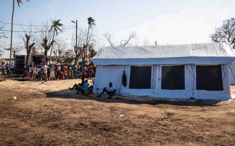 People wait in line for food at a relief camp set up for victims of Cyclone Idai who have fled to Beira. Picture: Christa Eybers/EWN