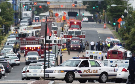 Police and firefighters respond to the report of a shooting at the Navy Yard in Washington, DC, 16 September 2013. Picture: Saul Loeb/AFP