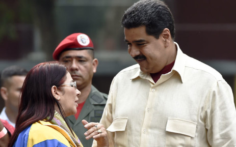 FILE: Supporters of Venezuelan President Nicolas Maduro (R) listens to his wife, First Lady Cilia Flores, during a rally in Caracas on 19 April 2016. Picture: Juan Barreto/AFP.