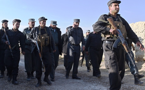 FILE: In this photograph taken on November 18, 2014, Kabul's police chief general Zahir Zahir (3rd R) talks on the phone as he arrives at the site of a suicide attack at the entrance of a foreign-run compound in Kabul. Picture: EPA.