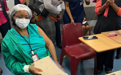 Dr Ornica Khobo-Mpe, head of clinical unit at Steve Biko Academic Hospital, waits to get getting vaccinated against the coronavirus on 17 February 2021. Picture: @GautengHealth/Twitter