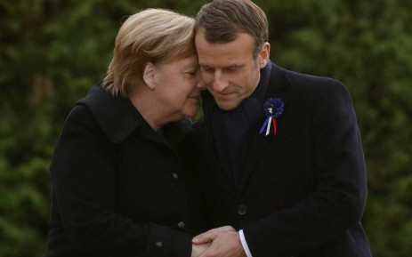 French President Emmanuel Macron and German Chancellor Angela Merkel hug after unveiling a plaque in a French-German ceremony in the clearing of Rethondes (the Glade of the Armistice) in Compiegne, northern France, on 10 November 2018 as part of commemorations marking the 100th anniversary of the 11 November 1918 armistice, ending World War I. Picture: AFP