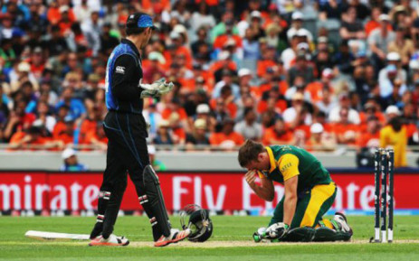 South African captain AB de Villiers falls to his knees after New Zealand beat the Proteas in the 2015 ICC Cricket World Cup semifinals at Eden Park, Auckland on 24 March 2015. Picture: CSA.