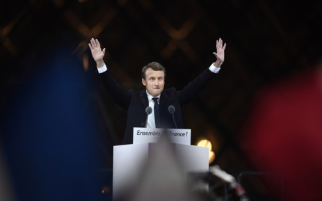 French president-elect Emmanuel Macron greets supporters as he arrives to deliver a speech in front of the Pyramid at the Louvre Museum in Paris on 7 May, 2017, after the second round of the French presidential election. Picture: AFP.