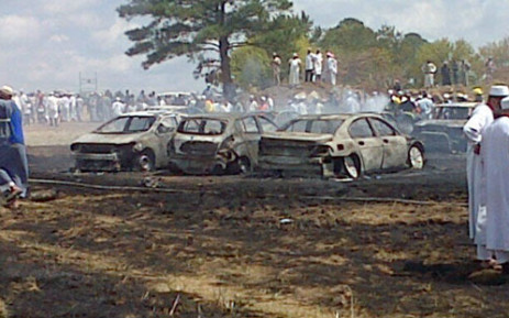 There was a massive fire at a parking lot near Maxwell Drive in Woodmead on 29 March 2013. It is believed 15 cars were set alight. Picture: Twitter