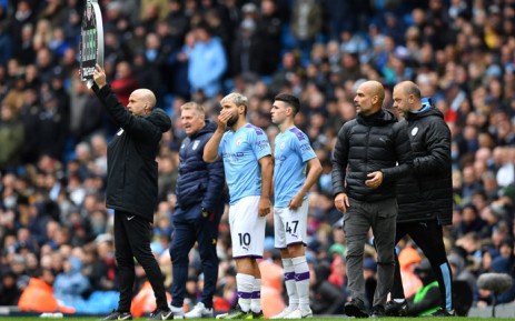FILE: Manchester City manager Pep Guardiola (2nd R) prepares to use his substitute players Sergio Aguero (C) and Phil Foden (3rd R) during the English Premier League football match between Manchester City and Aston Villa at the Etihad Stadium in Manchester, north west England, on 26 October 2019. Picture: AFP