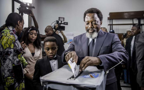 FILE: President of the Democratic Republic of Congo Joseph Kabila casts his vote along with his family at the Insititut de la Gombe polling station during general elections in Kinshasa on 30 December 2018. Picture: AFP.