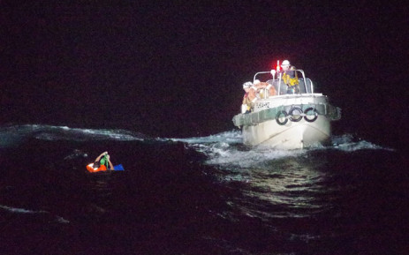 This handout picture taken on 2 September 2020 and provided by 10th Regional Coast Guard Headquarters on 3 September 2020 shows coast guards rescuing a Filipino man off Amami Oshima island after the ship he was on sank. Picture: AFP