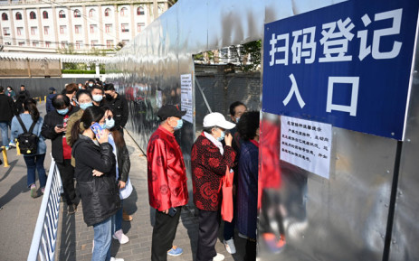 People line up to be vaccinated against the COVID-19 coronavirus, outside a residential compound in Beijing on 8 April 2021. Picture: Leo Ramirez/AFP