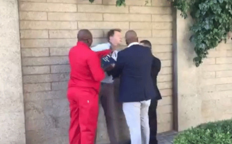 A screengrab shows Media24's Adrian de Kock allegedly being assaulted by EFF deputy president Floyd Shivambu on Tuesday 20 March 2018. Picture: @JasonFelix/Twitter