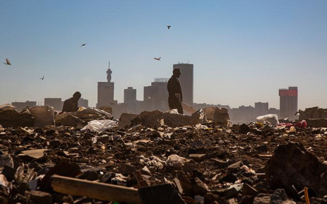 A waste picker is seen in the Robinson Deep landfill site in Johannesburg. The site has a maximum of 3 years left until it reaches capacity. From 1 July Johannesburg residents are compelled to separate their garbage from recyclable material in an effort to avoid reaching this point.  Picture: Christa Eybers/EWN