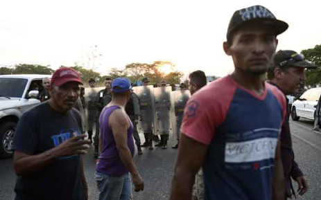 Local residents get angry as the National Guard blocks the main highway to keep out convoys heading to the border with Colombia to try to collect the humanitarian aid that the government of President Nicolas Maduro is not allowing into the country, in San Carlos, Cojedes state, Venezuela on 21 February 2019. Picture: AFP