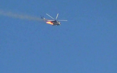 An image grab that was taken from a video uploaded on YouTube on August 27, 2012 showing a burning Syrian combat helicopter crashing. Picture: AFP