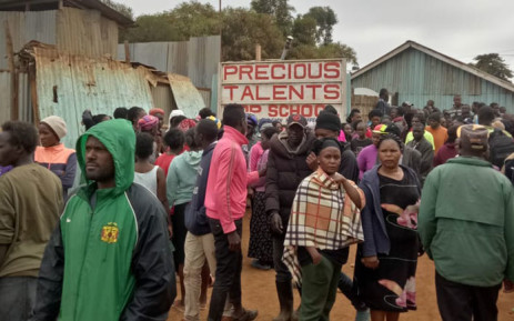 Parents and residents of Dagoretti in Nairobi at the Precious Talent Academy on 23 September 2019 after a classroom collapsed. Picture: @StJohnKenya/Twitter