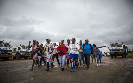 Protesters in Vuwani sing and dance under police supervision. Picture: Thomas Holder/EWN