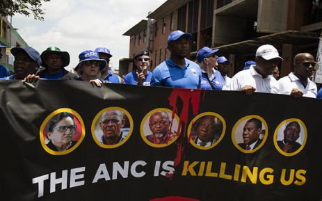 DA members march through Johannesburg streets before unveiling a new billboard on 16 January 2019. Picture: Kayleen Morgan/EWN