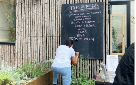 A volunteer writes the day's list of titles of 'human books' on a blackboard at the Human Library in Copenhagen on August 29, 2021.  Picture: AFP