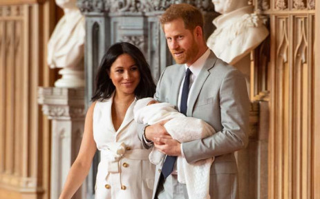 Britain's Prince Harry, Duke of Sussex, and his wife Meghan, Duchess of Sussex, pose for a photo with their newborn baby son in St George's Hall at Windsor Castle in Windsor on 8 May 2019. Picture: AFP.
