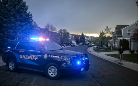 Police officers stand outside the home of one of the alleged gunmen behind the STEM School Highlands Ranch shooting in Highlands Ranch, Colorado on 7 May 2019. Picture: AFP