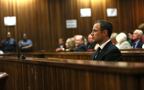 Paralympian Oscar Pistorius is seen during judgment in his murder trial at the High Court in Pretoria on Friday, 12 September 2014. Picture: Pool.