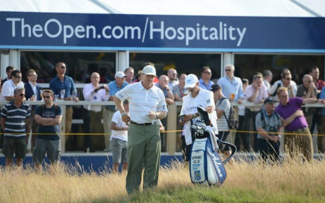 Ernie Els tries to locate his ball in the deep rough during a difficult opening round at the 2014 Open Championship. Picture: Official Open Championship Facebook Page