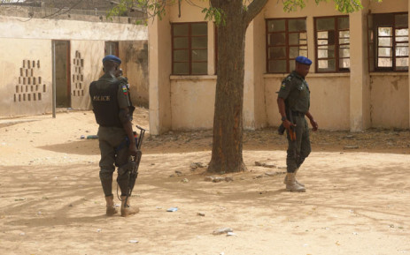 FILE: Policemen stand on guard at the premises of Government Girls Technical College, where 110 girls were kidnapped by Boko Haram Islamists at Dapchi town in northern Nigerian on 19 February 2018. Picture: AFP.