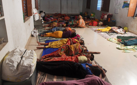 Indian people evacuated for safety rest in a temporary cyclone relief shelter in Puri in the eastern Indian state of Odisha on 3 May 2019, as cyclone Fani approaches the Indian coastline. Picture: AFP