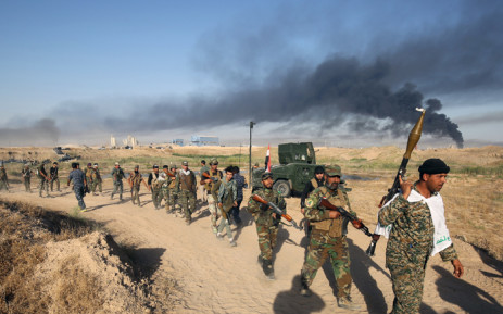 FILE: Iraqi pro-government forces on the move. Picture: AFP.