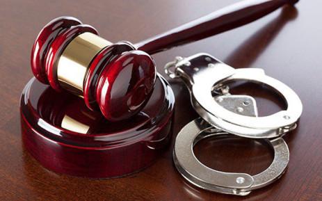 Handcuffs, gavel. Picture: SAPS.