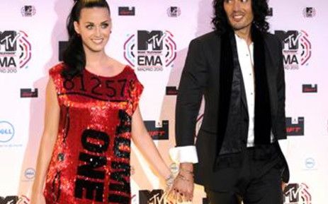 US singer Katy Perry poses with her husband, British comic Russel Brand on the red carpet on 7 November 2010. Picture: AFP
