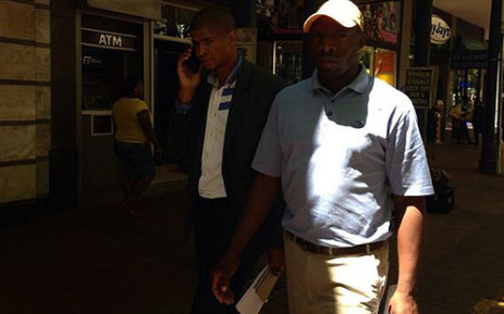 One of the toilet wars ring leaders Loyiso Nkohla [left] was spotted near the Provincial Legislature on 29 November 2013. Picture: Carmel Loggenberg/EWN