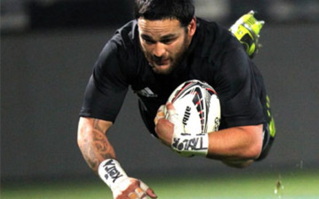 Piri Weepu scores a try against Fiji during their rugby union Test match at Carisbrook Stadium in Dunedin on 22 July 2011. Picture: AFP