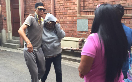 The woman accused of abducting Zephany Nurse is being covered by her supporters immediately and bundled her in a car after her court appearance on 6 March 2015 in Cape Town. Picture:Monique Mortlock/EWN.