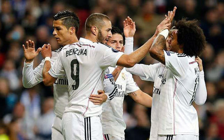 Real Madrid's Karim Benzema celebrates with Ronaldo (L) and Marcelo (R) after scoring a goal against Liverpool on 4 November 2014. Picture: Real Madrid Facebook page.