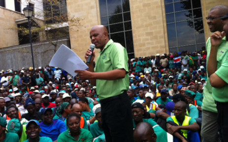 Amcu president Joseph Mathunjwa delivers a speech during the handing of memorandum at the Impala Platinum's headquarters in Johannesburg on 27 March 2014. Picture: Gia Nicolaides/EWN.